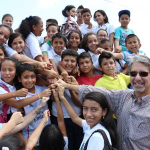 U.S Ambassador to Colombia Kevin Whitaker is greeted by children at Campo Hermoso in the Colombian department of Caquetá, during his recent visit to USAID projects in the area.