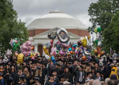 Graduates celebrating in front of the rotunda